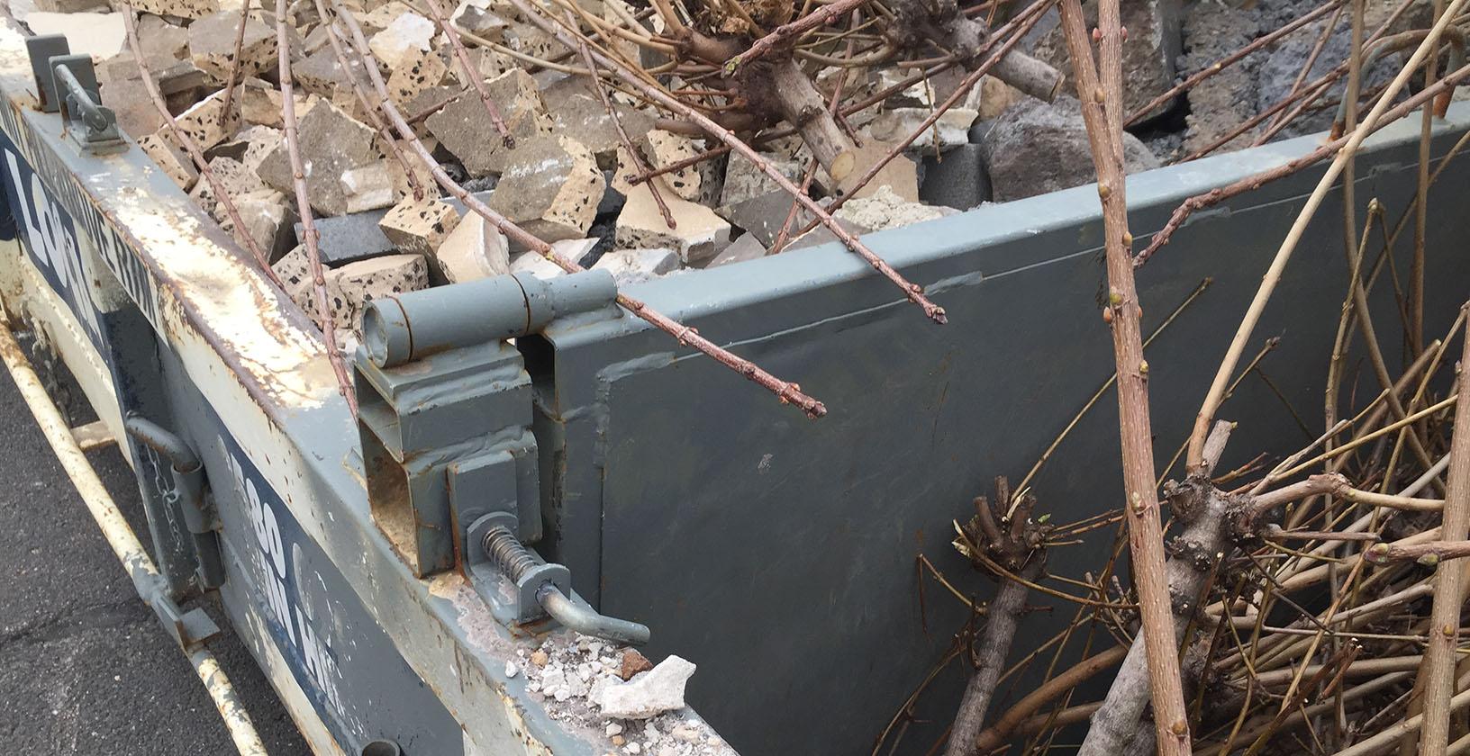 Bin divider for waste management on construction sites